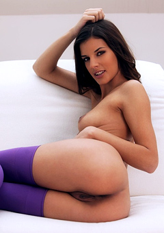 Candice Luca In Purple Stockings On A Couch